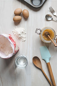 Flour, eggs, baking utensils, and honey. Image by Calum Lewis