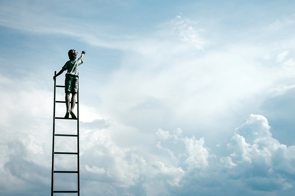 Image of a boy climbing the ladder to the clouds