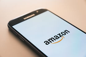 A phone screen showing the Amazon logo. Image by Christian Wiediger