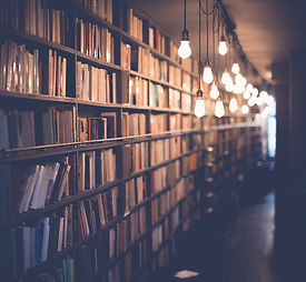 A background image depicting a library shelf with glowing edison bulbs nearby