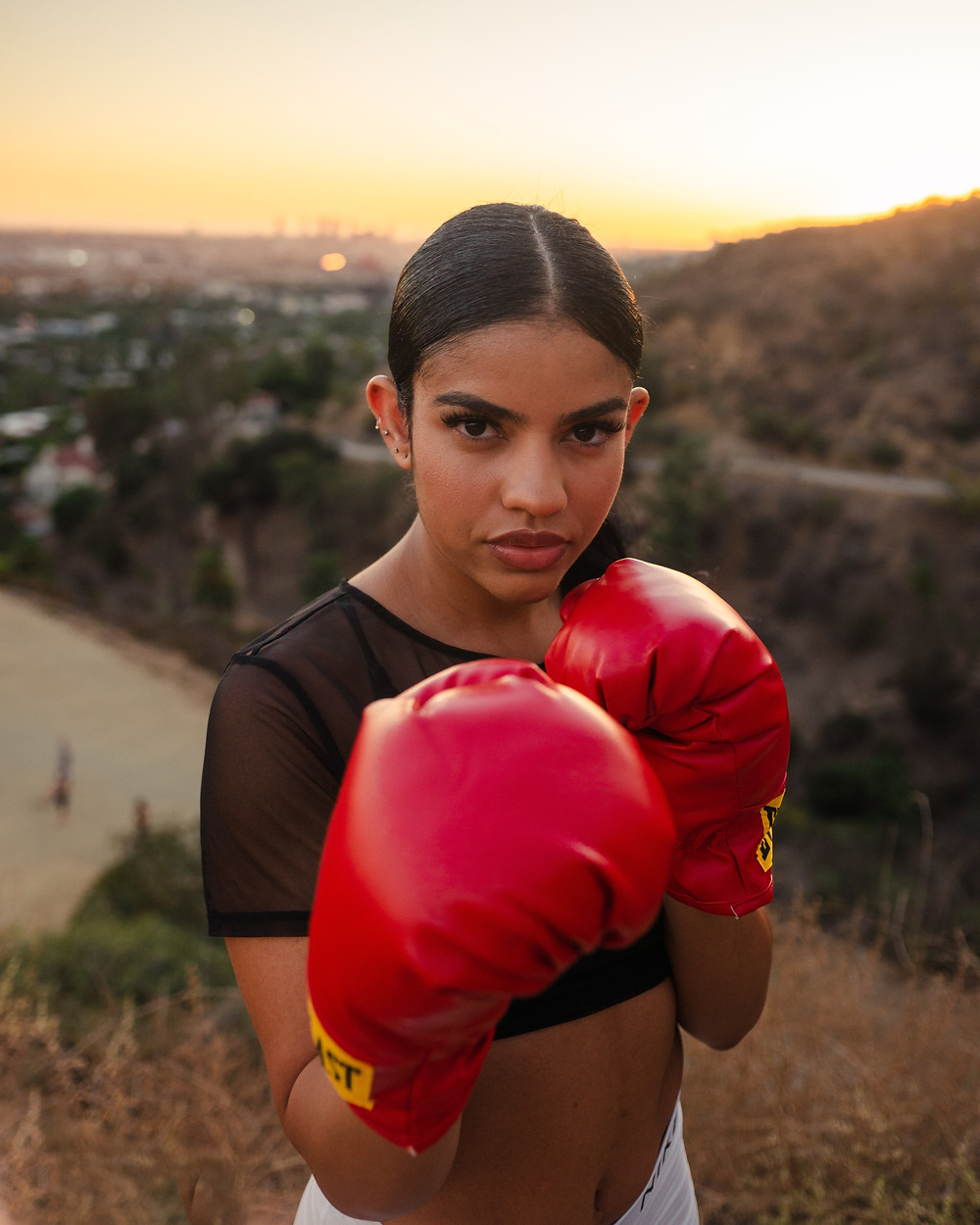 Woman in boxing gloves.