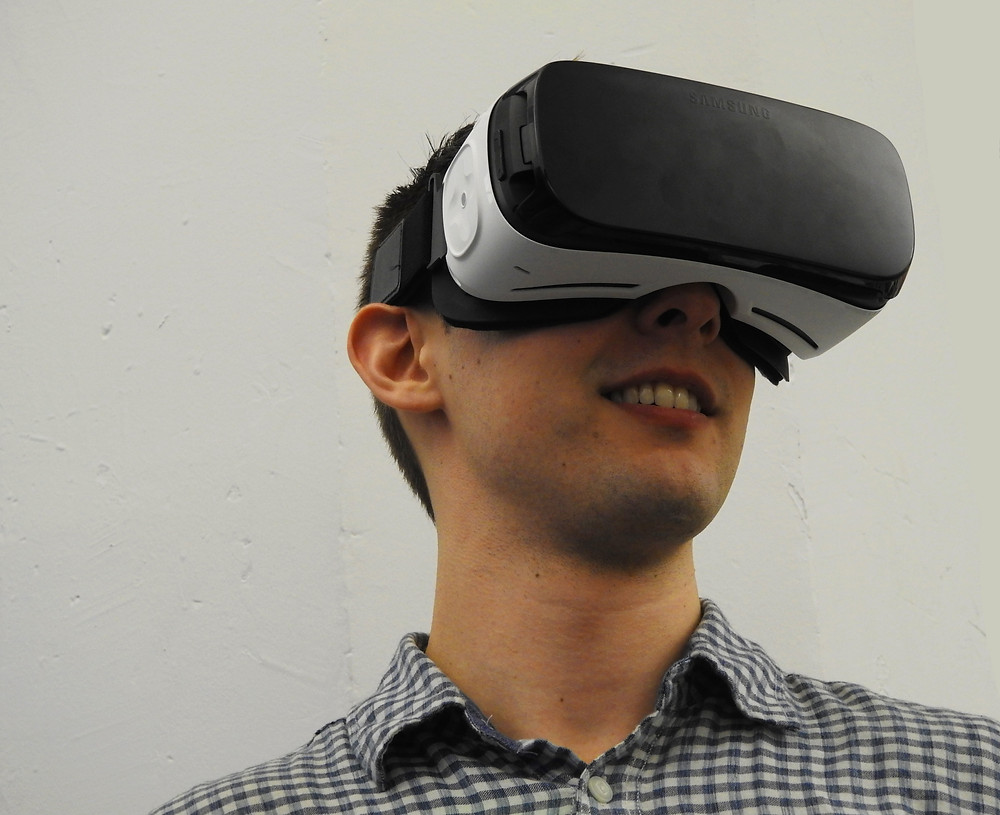 A person playing with a VR headset.