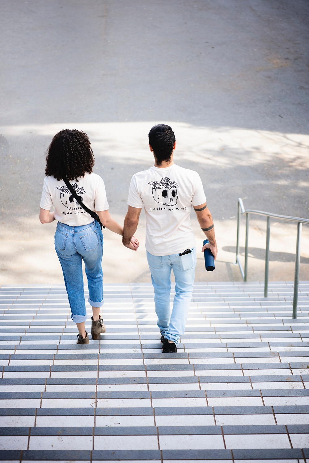couple walking down the stairs holding hands