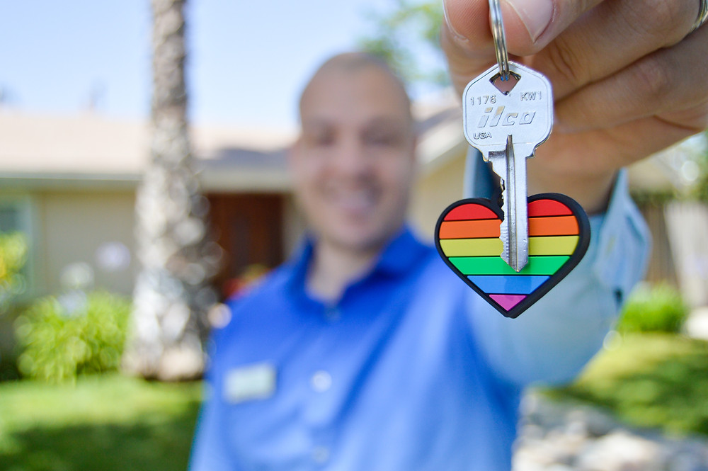 Man holding key with rainbow key chain