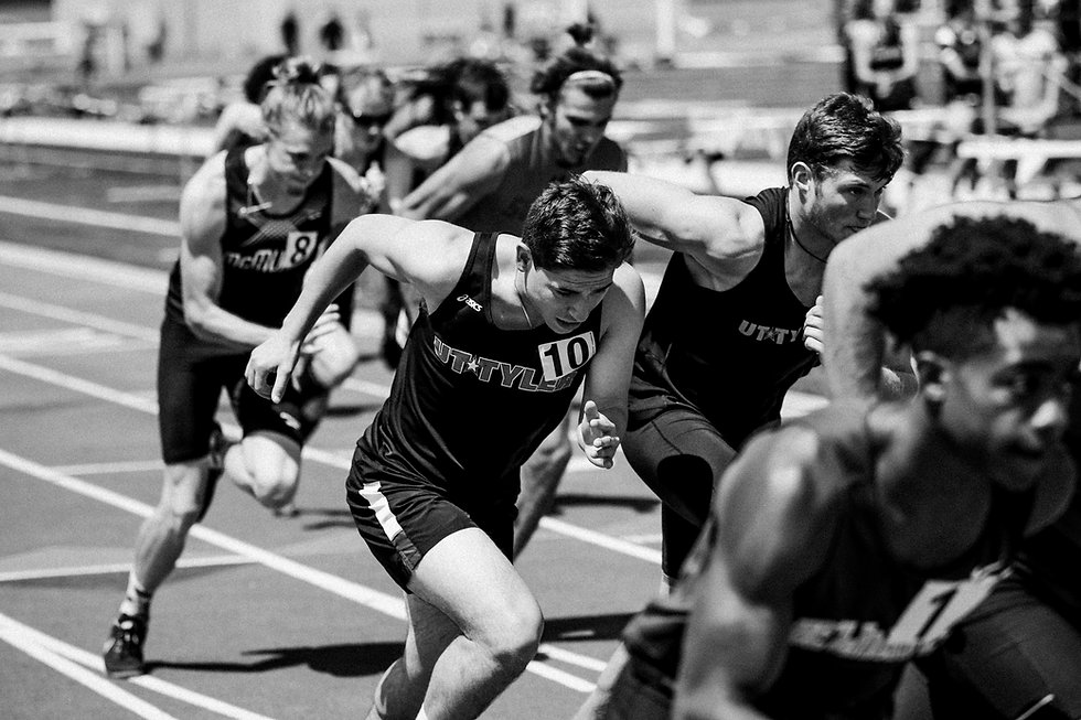 Image of runners racing at a track meet.
