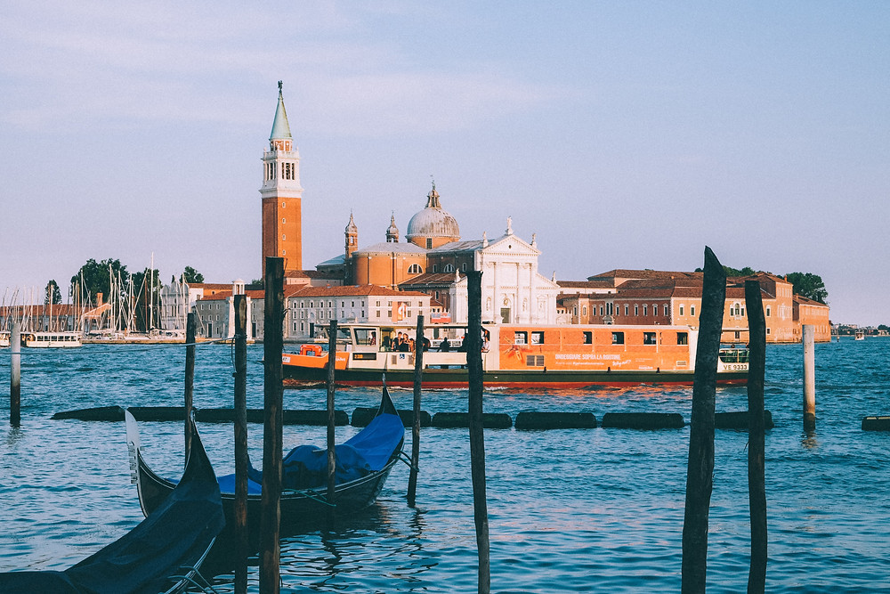Gondolas in the foreground, with San Giorgio Maggiore (island with a church and bell tower) behind