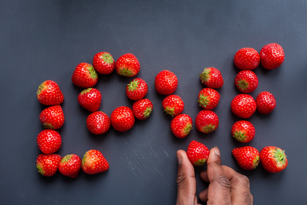 Word love written out in strawberries