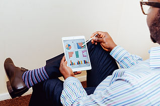 Man with tablet showing business consulting analytics