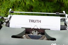 "Typewriter typing under the heading ""Truth"""