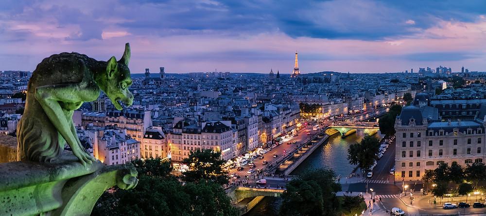 Photo of a building gargoyle in Paris.