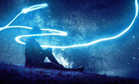 Seated person surrounded by stars and energy, asking what is self-awareness?