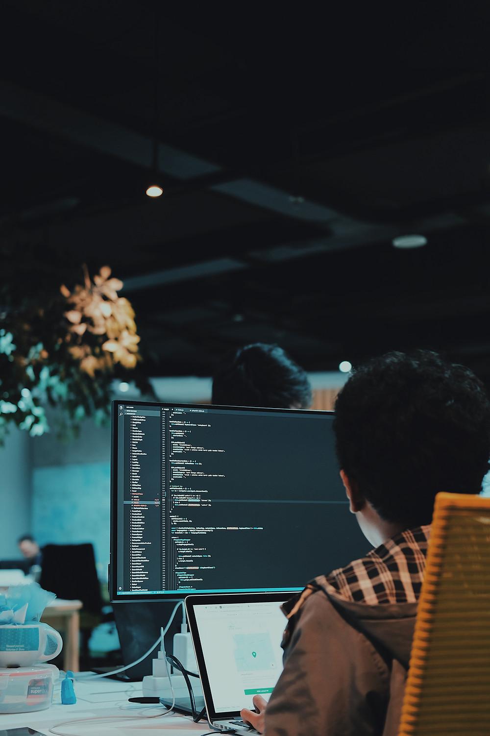Programmer in dark office