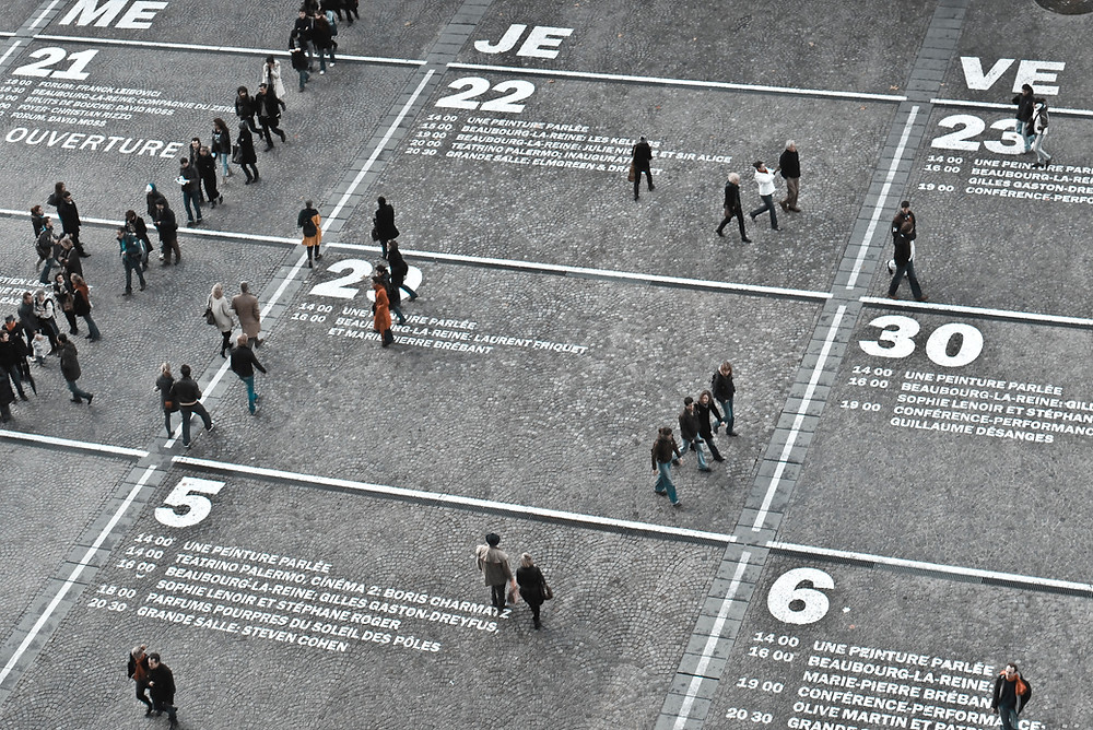 People walking on a large calendar