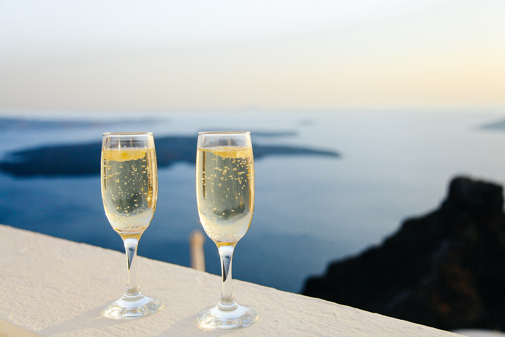 champagne glasses on the coastal shoreline