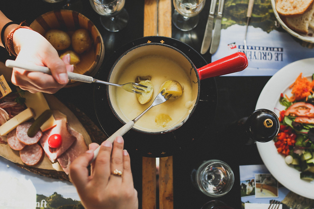 fondue-surrounded-by-dipping-items-meats-vegetables