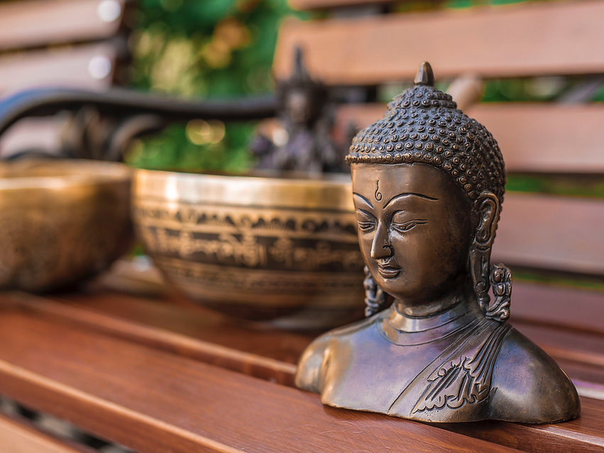 Bronze Budda in shades of brown background.