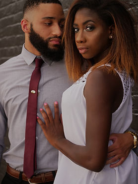Black power couple holding onto each other |  Marriage counseling and couples therapy in detroit, mi | couples therapy in Southfield, MI 48075 | marriage counseling | marriage counseling near me | couples therapist | 48226 | 48243
