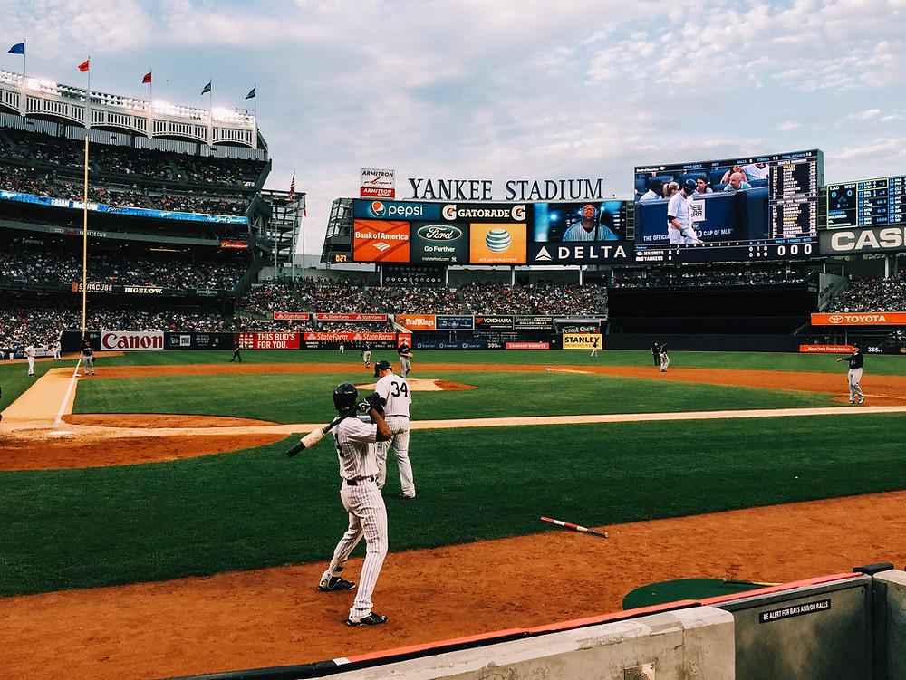 Yankees stadium baseball new york city sports players on field getting ready to bat
