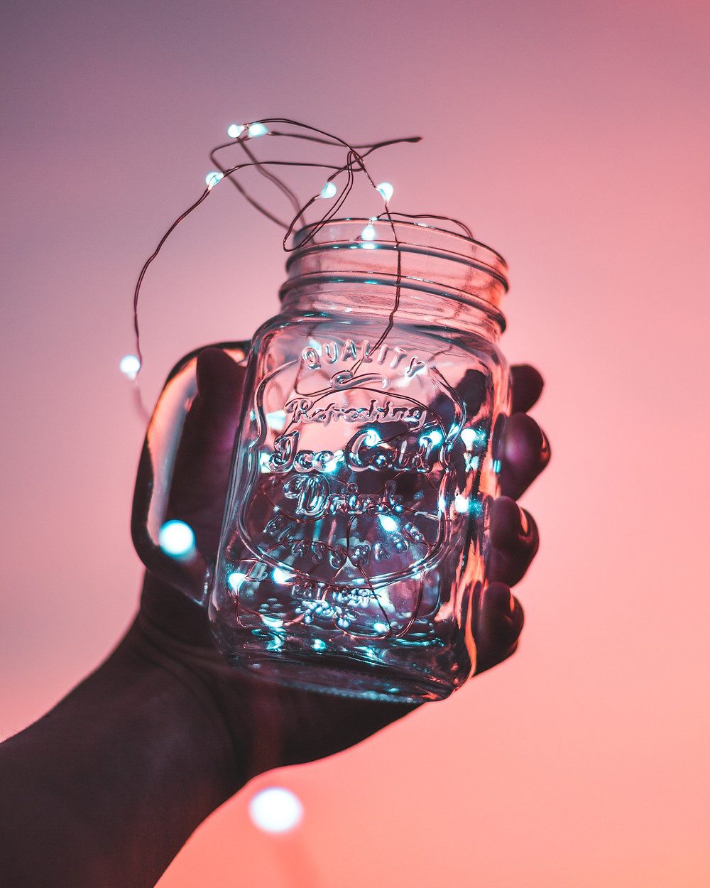 Cheap and effective, a dollar store string light and a jar, could create a dreamy look.