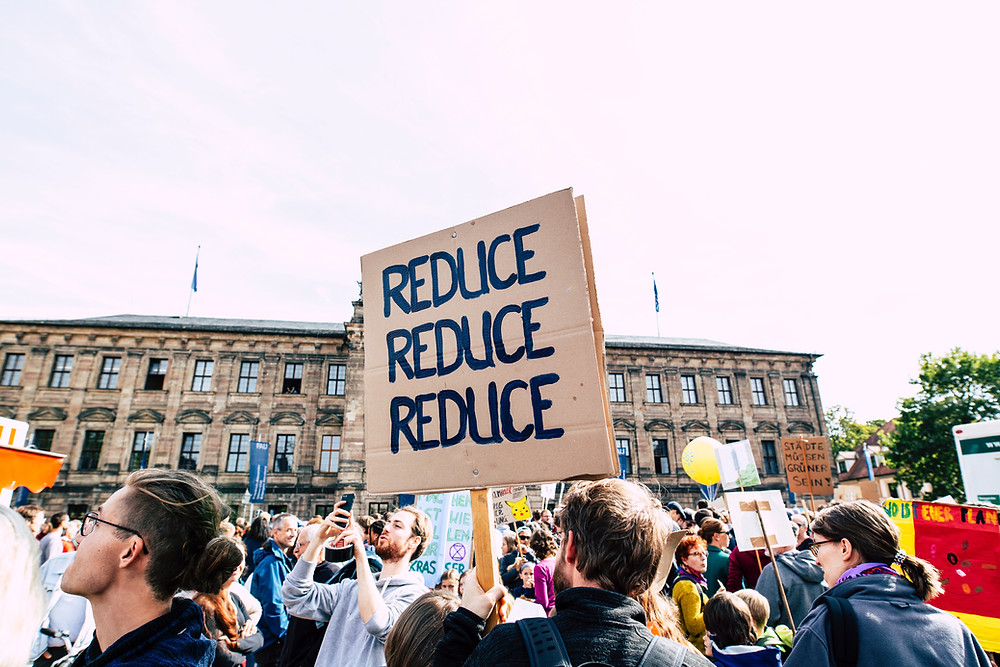 Reduce sign at rally