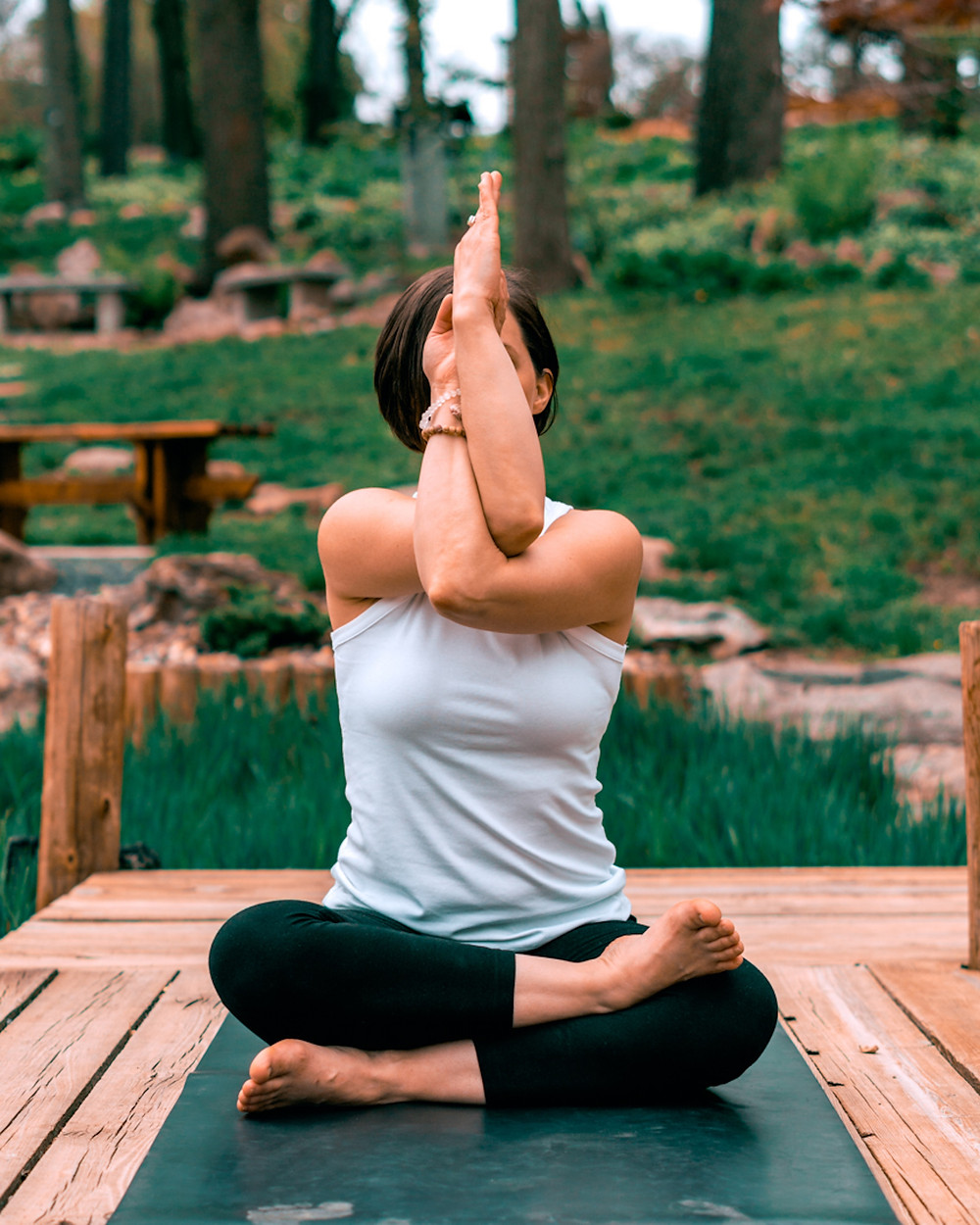 Tibetan Prayer Pose crosses over the energies.