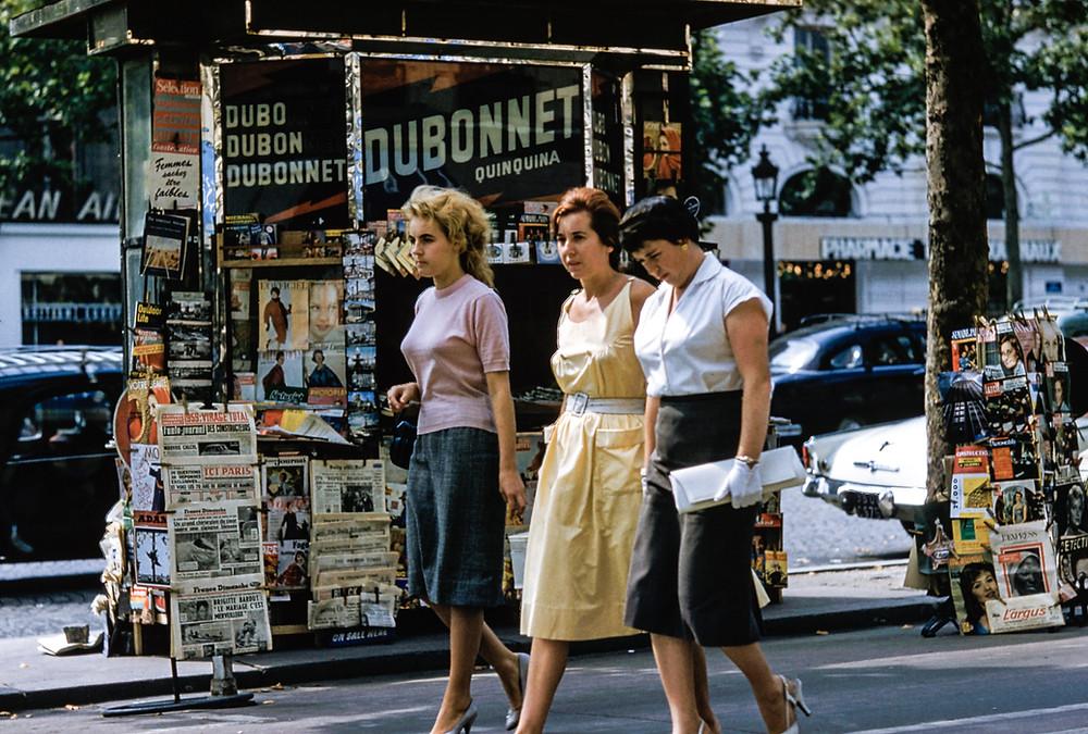 Vintage Group of Girls Walking Down Busy Street