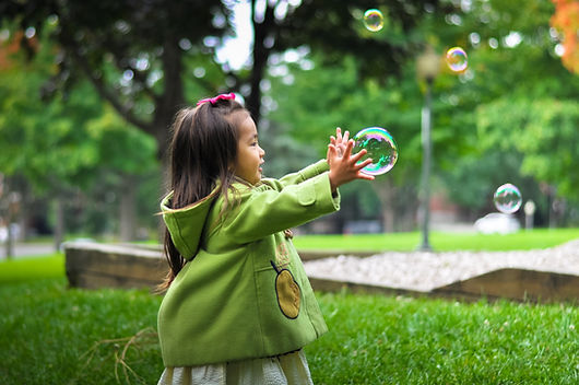 Little Girl Catching Bubbles | Georgia Center For Autism And Developmental Pediatrics
