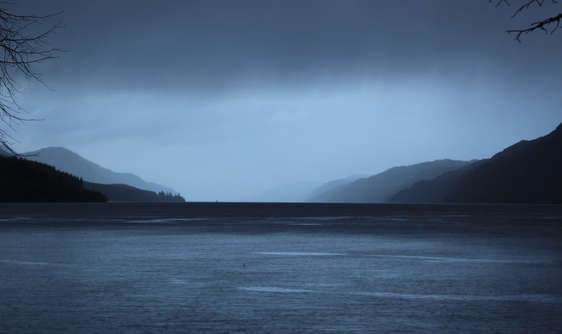 mysterious loch ness with dark sky and dark water in scotland
