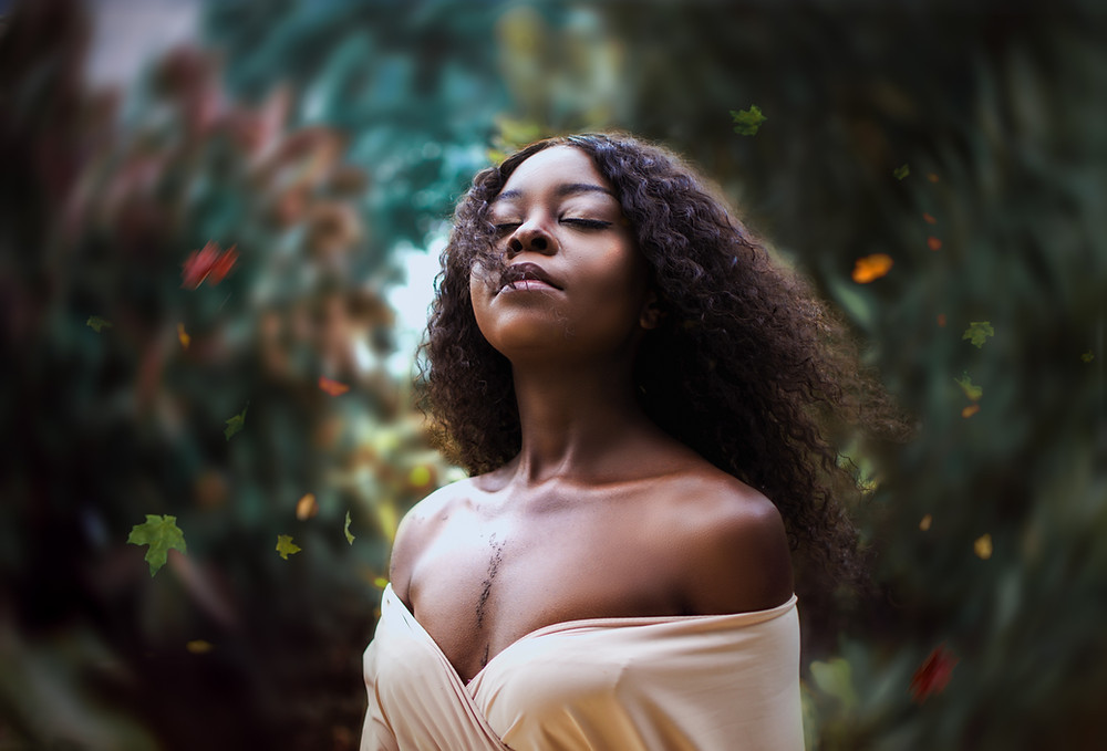 beautiful black woman curls serene