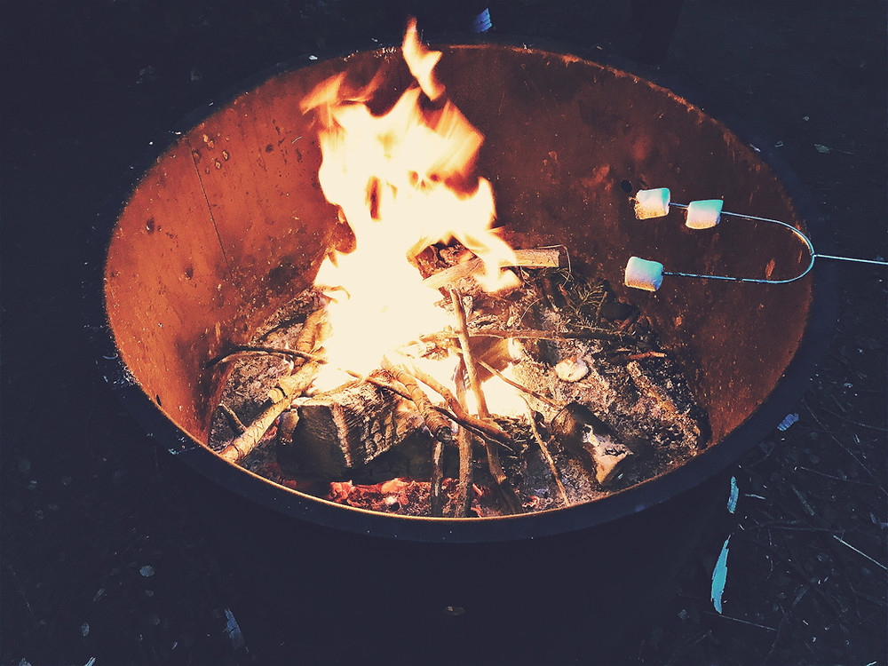 outdoor firepit with roasting marshmallows