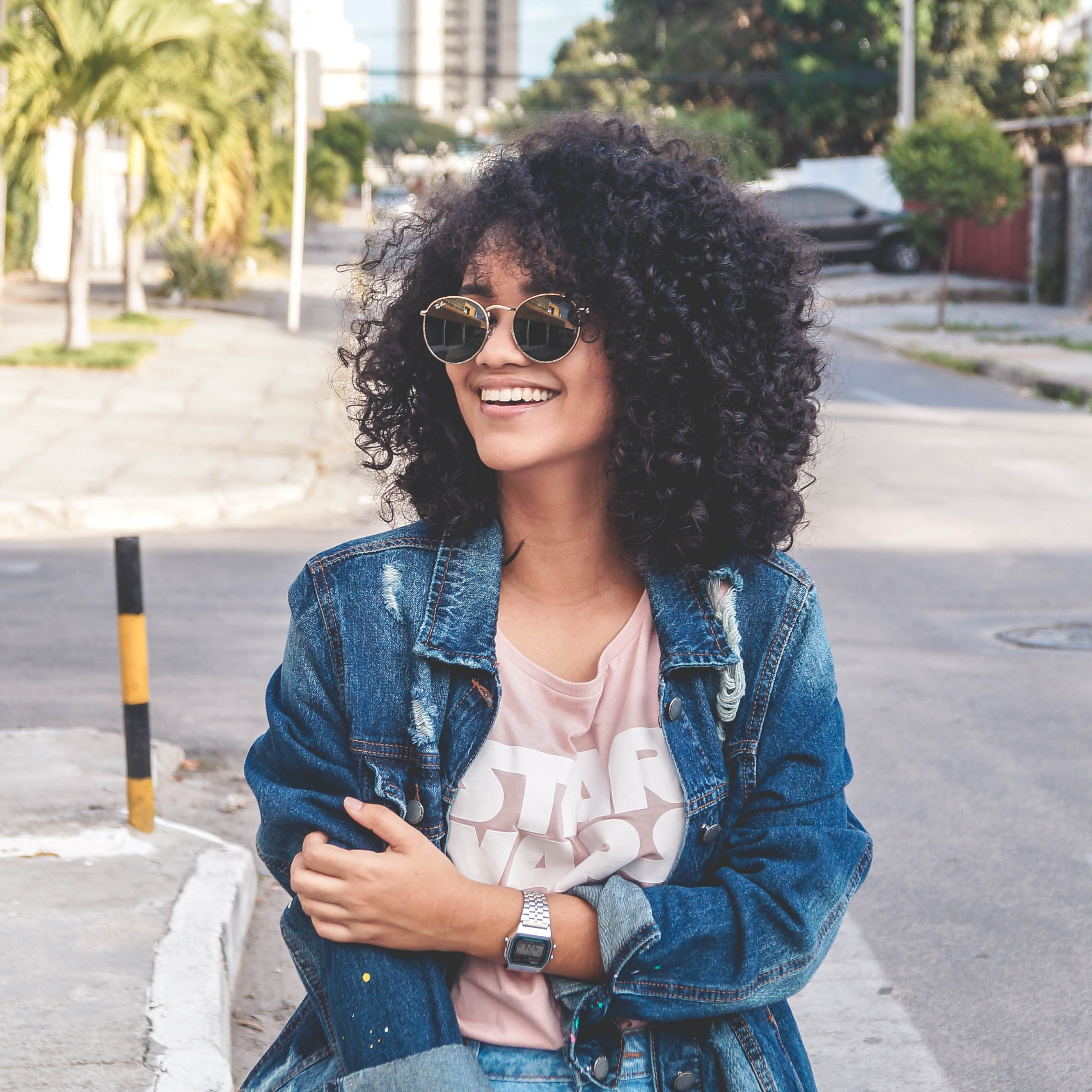 lady with curly hair wearing sunglasses
