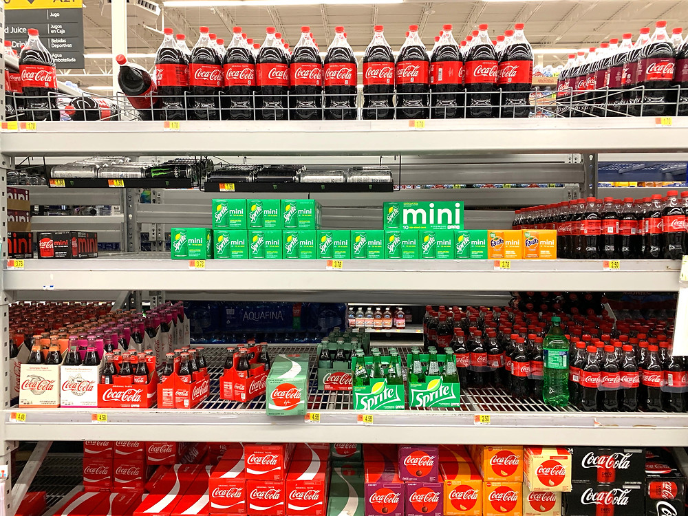 soft drinks on a shelf in a store