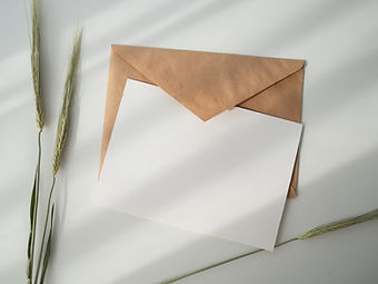 Brown craft paper envelope with white card