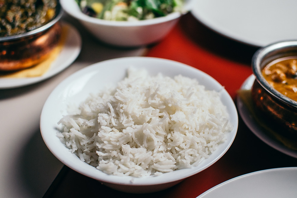 white rice should be avoided in weight loss journey as it is refers to as bad carbs instead brown rice can be taken
