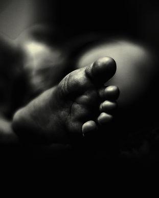Black infant foot, giref and infant loss