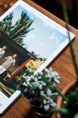 corner of magazine on wood table