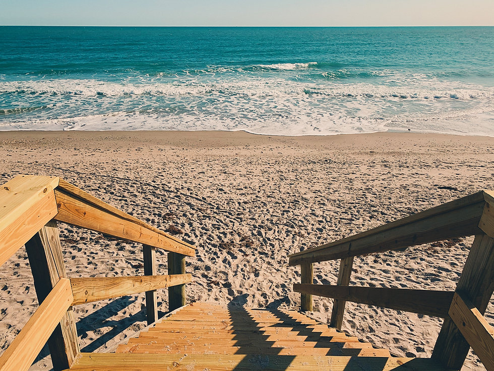 Image of a pier leading to a relaxing ocean by Skyler Smith