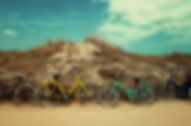 4 bicycles by dunes