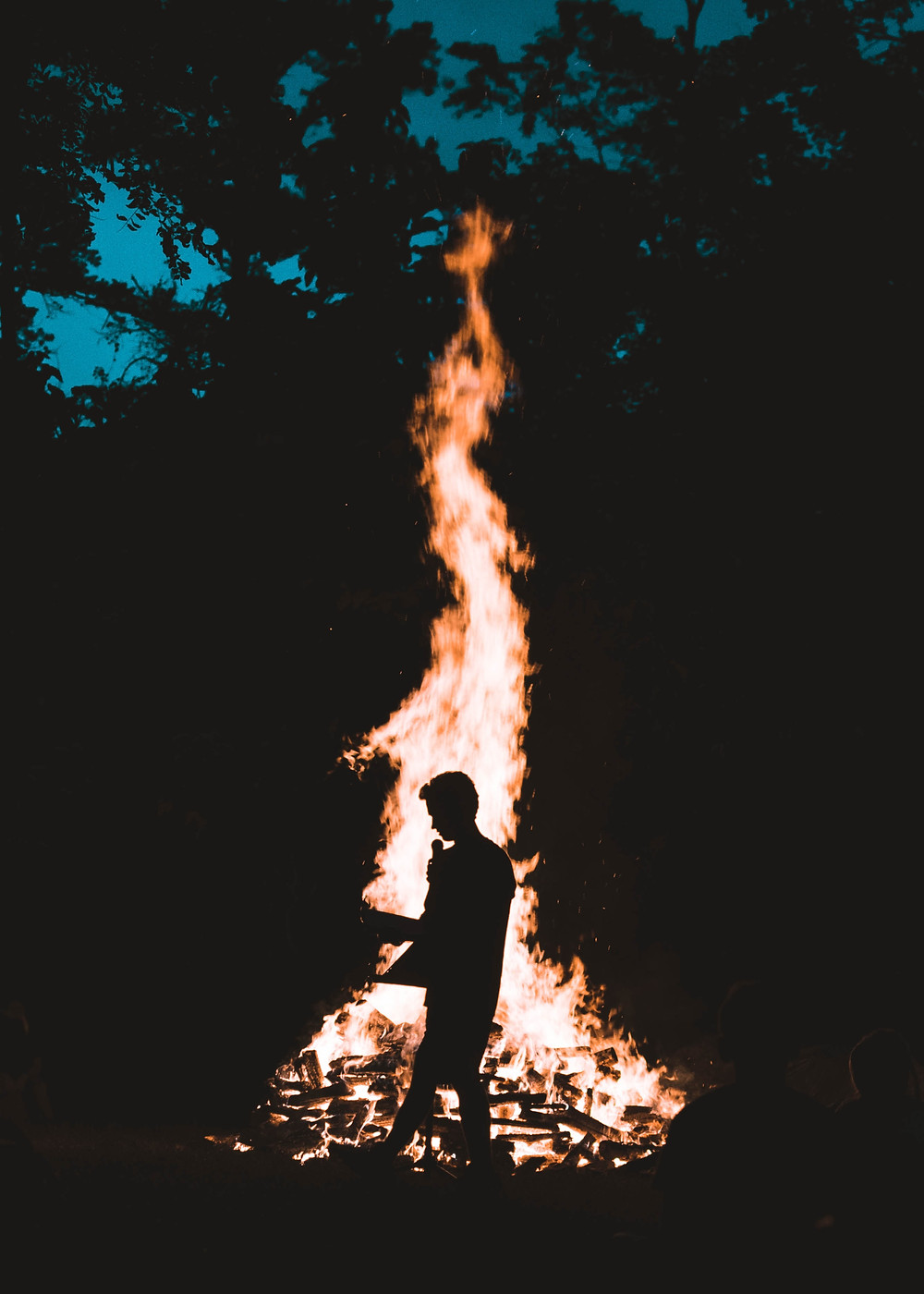 pillar of flame and shadow of a person