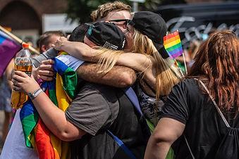 pride celebrants embracing by Jana Sabeth