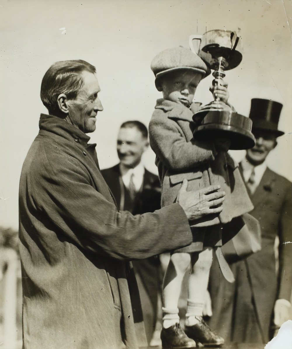 child holding a trophy