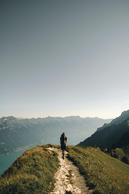 a person starting a long trek on a beautiful hillside trail