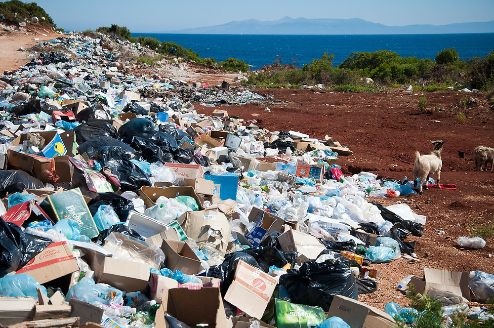 Mountain of rubbish and garbage on the beach by the sea