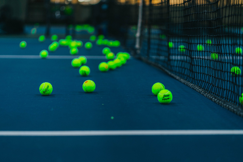 A tennis court covered in tennis balls.
