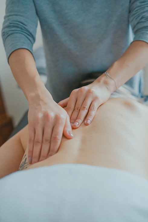 Physiotherapist treating back pain