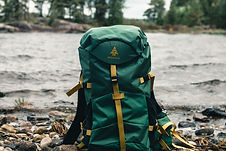 Avalanch bags image - picture of hiking backpack sat on rocks near a stream