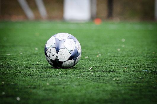 star-soccer-ball-on-grass