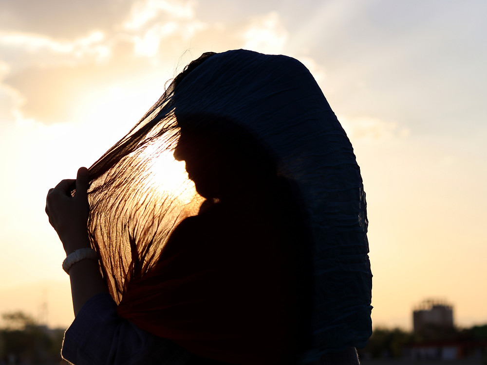 Silhouette of a woman holding her hair