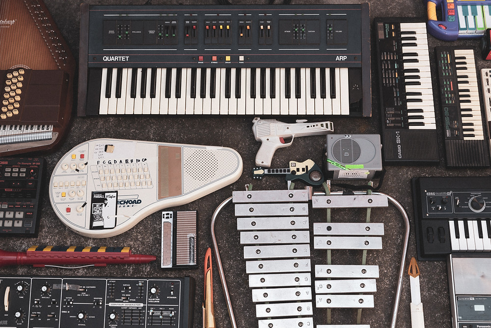 An assortment of electronic and acoustic instruments