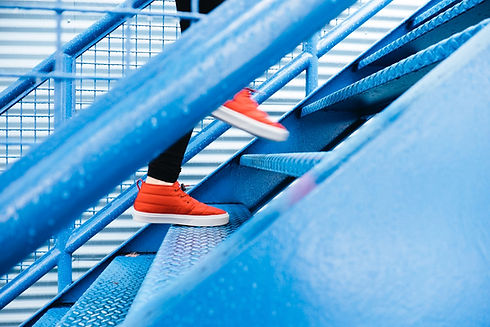 Shoes climbing stairs towards redundancy recovery coaching.